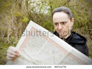 stock-photo-woman-lost-hiking-confused-looking-at-map-99744776